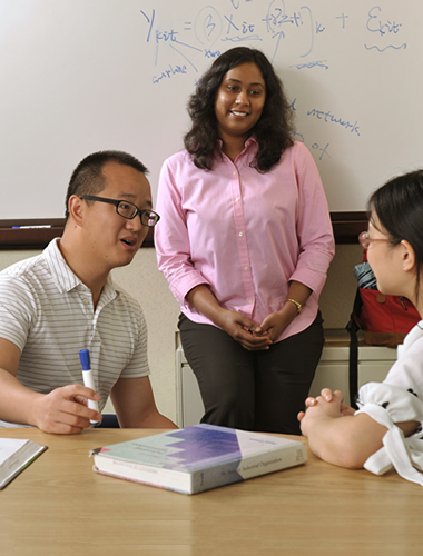 Professor Huaxia Rui working with students - 380 x 500