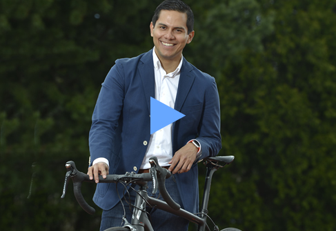 Jorge Rosales holding a bicycle - 20 - 487 x335