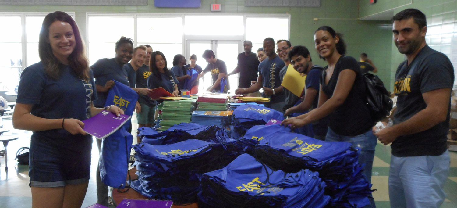 Simon Business School students volunteer in the local Rochester community